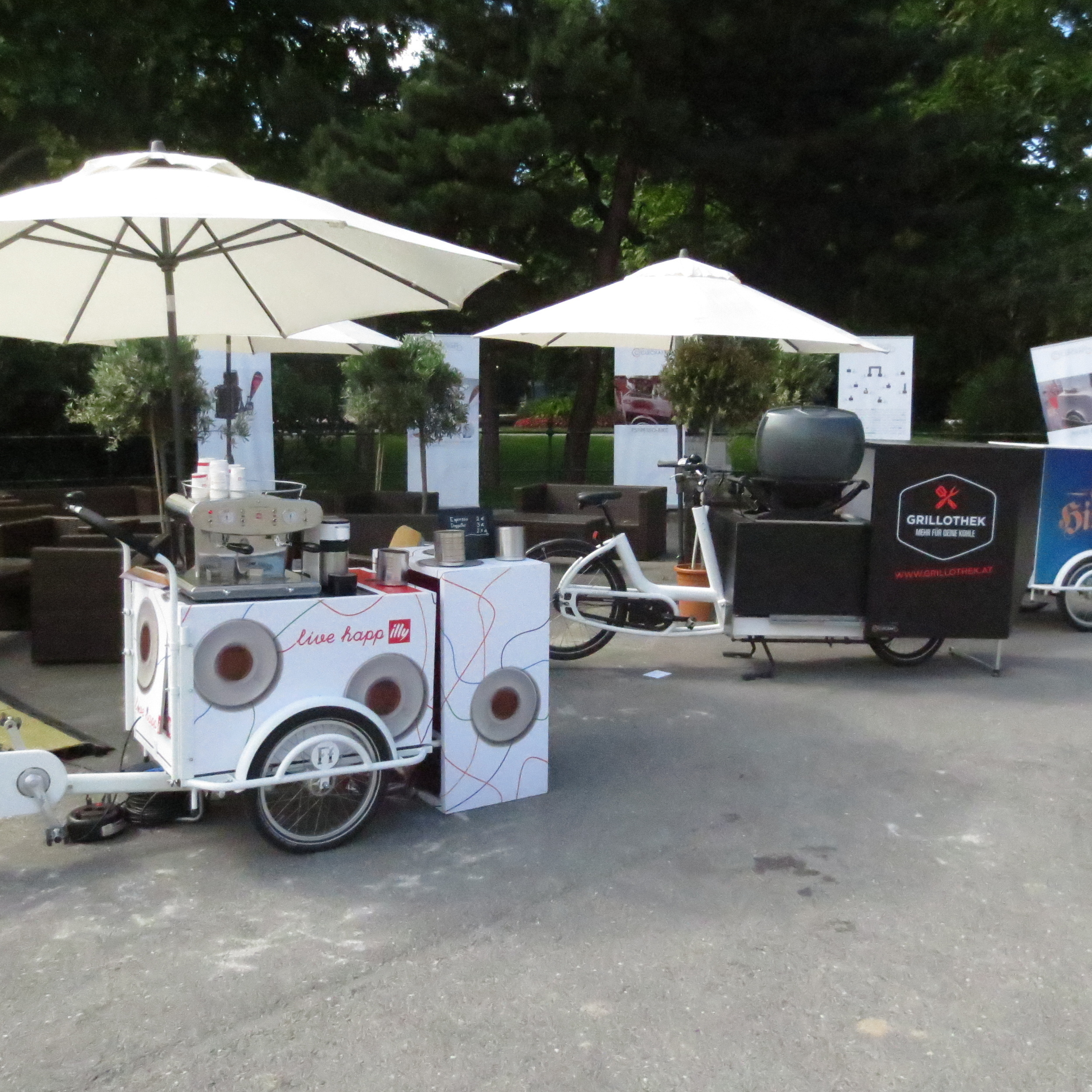 two cargo bikes, on the one there is a espresso machine installed and on the other there is a grill station