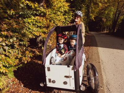 Mother with two children on a cargo bike