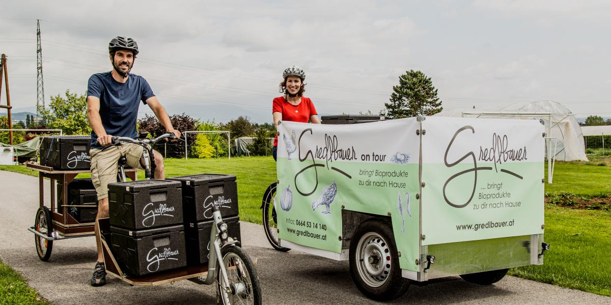 The image shows how  Gredlbauer delivers their ecological products on a cargo bike.