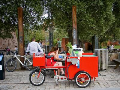 a red cargo bike built into a mobile snack bar